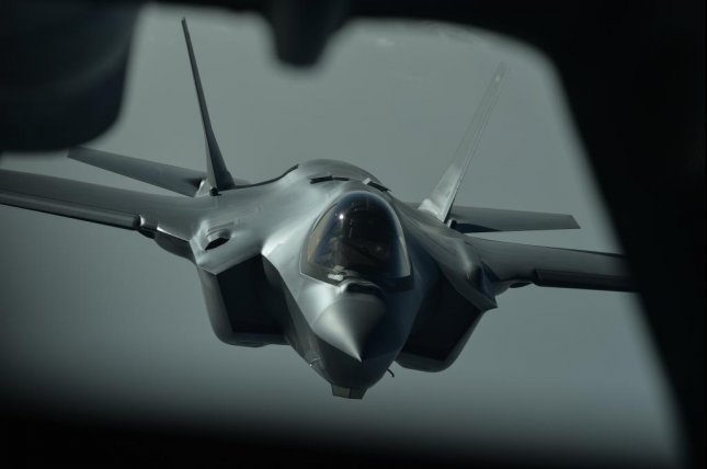 A F-35A prepares to connect with a KC-10 during an aerial refueling mission above an undisclosed location on Tuesday. The Air Force sent two F-35As on the aircraft's first combat mission this week. Photo by Staff Sgt. Chris Drzazgowski/U.S. Air Force