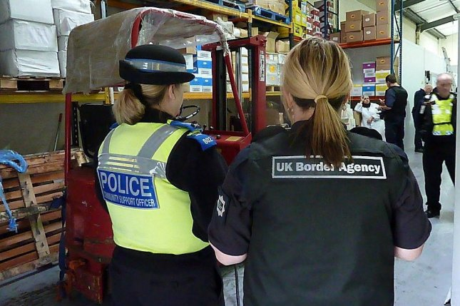 A British police officer and a UK Border Force officer, pictured in 2010. (Flickr/UK Home Office)