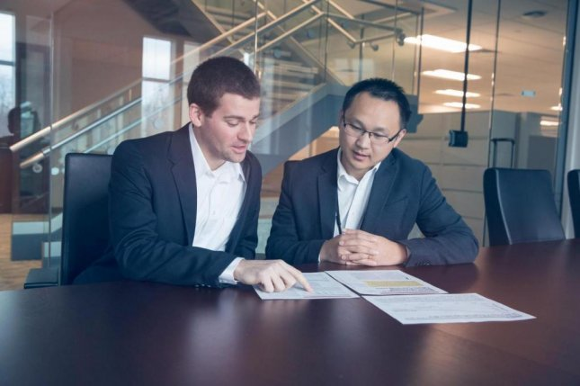 Brett Lissenden, (left) a student in the University of Virginia's economics Ph.D. program, and Nengliang Aaron Yao, Ph.D., of the UVA School of Medicine's Department of Public Health Sciences, focused on how the Affordable Care Act affected early cancer diagnoses. Photo by Dan Addison/UVA