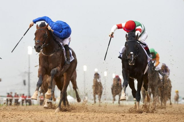 Thunder Snow, left, shown winning the UAE Derby in Dubai over Japan's Epicharis, will seek to win Sheik Mohammed's Godolphin Racing first Kentucky Derby victory on Saturday. Photo courtesy Dubai Racing Club/Andrew Watkins.