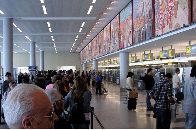 The immigration line at John F. Kennedy International Airport in New York City. A new rule proposed Thursday by the White House calls for an end to H-4 visas, which are awarded to spouses of holders of H-1B visas. File Photo by Beatrice Murch/Flickr