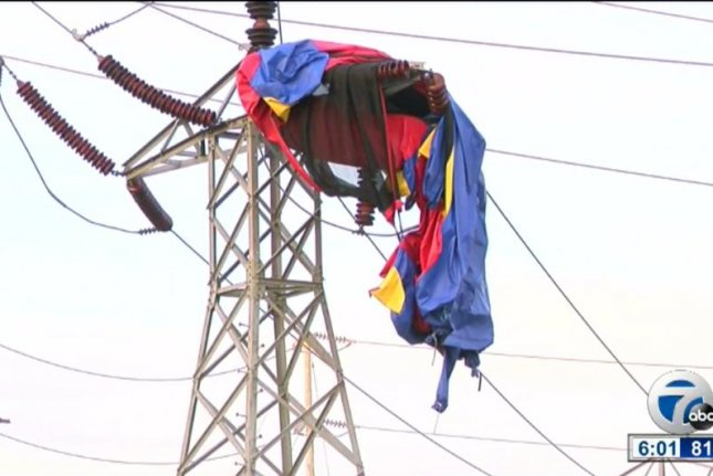 The remains of a bounce house that flew away from a New York state party on the wind and crashed into power lines. Screenshot: WKBW-TV