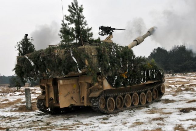 The U.S. Army Paladin self-propelled artillery fires 155mm rounds during training in Poland. U.S. Army photo