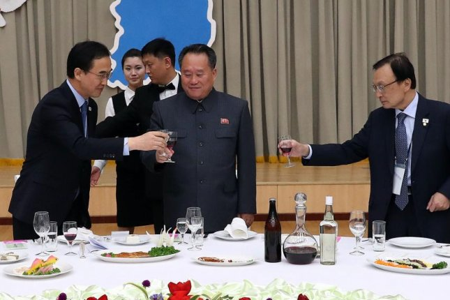 South Korea's Unification Minister Cho Myung-gyun (L), chairman of North Korea's Committee for Peaceful Reunification Ri Son Kwon (C) and Lee Hae-chan, head of South Korea's ruling Democratic Party, toast during a dinner in Pyongyang, North Korea, on Thursday. Photo by Yonhap/EPA-EFE