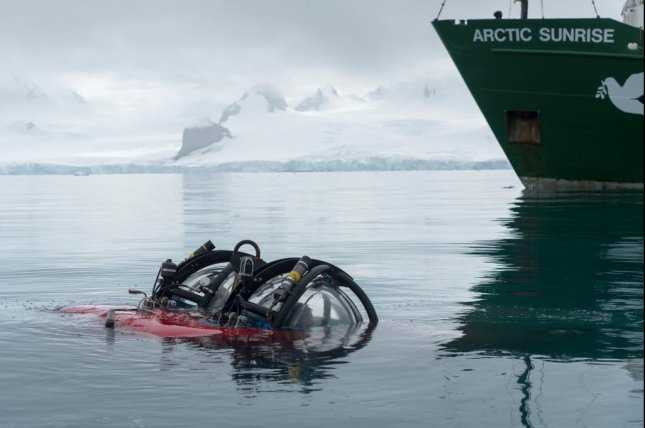 Greenpeace's two person submarine surfaces after a dive to the seabed near Livingston Island, Antarctica. Photo by Christian Åslund/Greenpeace