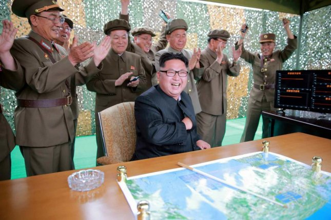 North Korea's strategic rocket forces commander, Kim Rak Kyom (L), applauds the launch of a Musudan missile in June 2016. Kim was not seen at the most recent missile launch, on Sunday. File Photo by KCNA