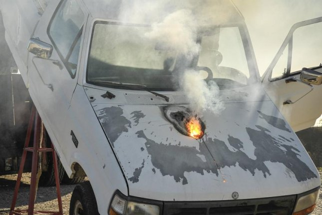 A 30-kilowatt laser weapon from Lockheed Martin burned through a truck from a distance of more than one mile. Photo: Lockheed Martin