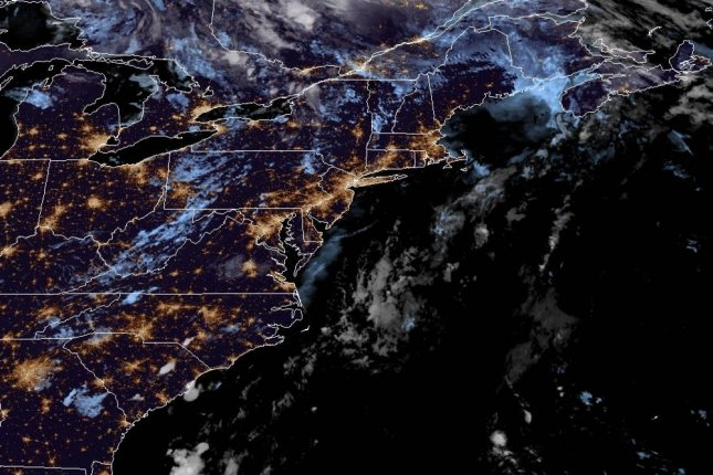 Tropical Storm Isaias is seen early Tuesday over the Mid-Atlantic United States after it made landfall in North Carolina on Monday night. Image courtesy NOAA/NHC