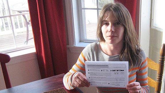 Kristen Tsetsi at her home in Connecticut with her Selective Service registration card. (Credit: Courtesy of Kristen Tsetsi.)