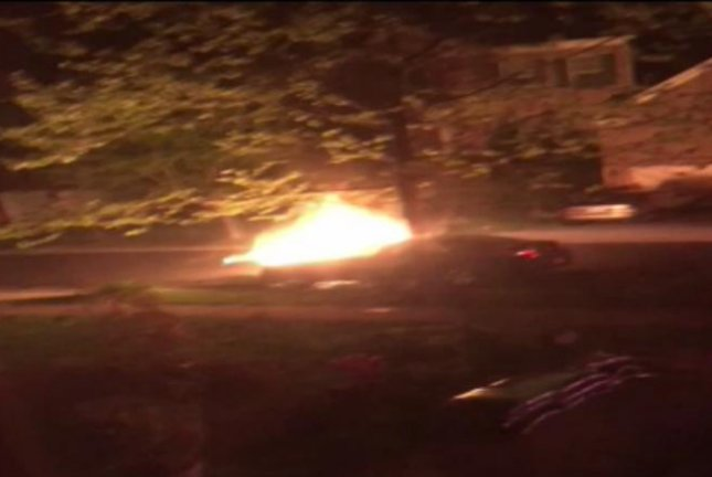 A new Chevrolet Malibu burns after allegedly being set aflame by the owner's spurned ex-girlfriend. Screenshot: WJLA-TV