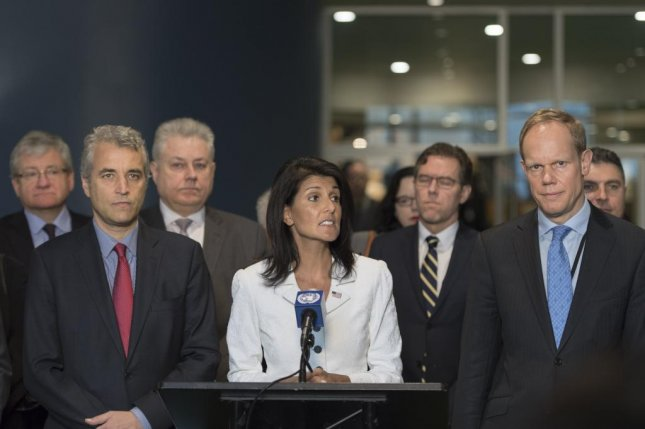 Nikki Haley, the U.S. ambassador to the United Nations, speaks to journalists on behalf of U.N. members opposed to the United Nations conference to prohibit nuclear weapons. She is flanked by Alexis Lamek (L), France's deputy ambassador to the United Nations; and Matthew Rycroft, the British ambassador. Photo courtesy Mark Garten/UN