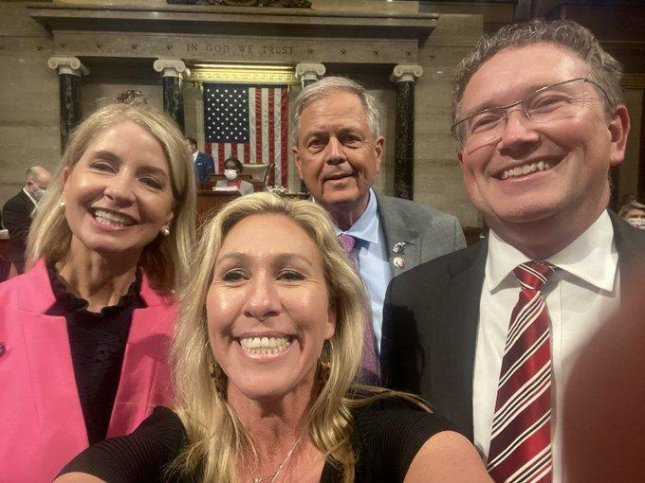 Reps. Mary Miller (L), Marjorie Taylor Greene, Ralph Norman and Thomas Massie pose for a maskless photograph in May from the House floor in protest of a mask mandate.Photo courtesy of Rep. Marjorie Taylor Greene/Twitter