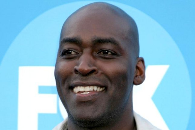 Actor Michael Jace, pictured here at a press event in 2006, was convicted of second-degree murder on Tuesday in the shooting death of his wife, April, in May 2014. He faces 40 years to life in state prison and is expected to be sentenced June 10. File Photo by Helga Esteb/Shutterstock