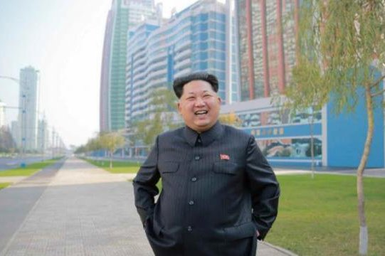 North Korean leader Kim Jong Un standing before Ryomyong Street. Building construction along the boulevard was hailed a miracle on Wednesday. File Photo by Rodong Sinmun