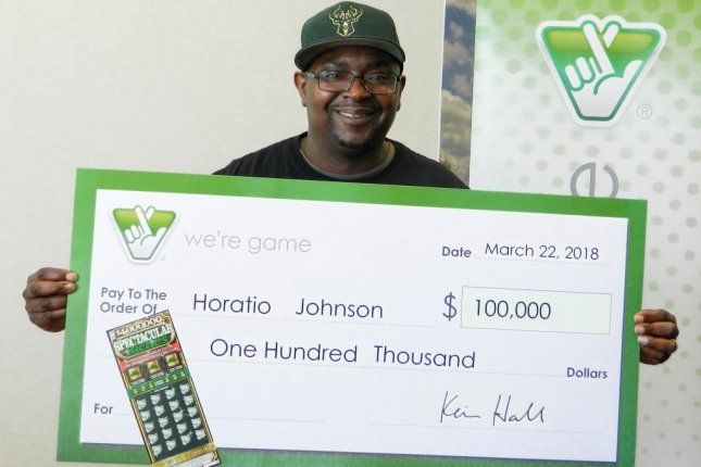 Uber driver Horatio Johnson said he wanted to avoid a red light at the end of his shift, so he pulled into a gas station where he won a $100,000 lottery jackpot. Photo courtesy of the Virginia Lottery