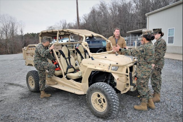 Jason Engstrom, center, a Utility Task Vehicle engineer with Program Executive Officer Land Systems, reviews planned upgrades for the vehicles in Quantico, Va., Dec. 4. Photo by Ashley Calingo/U.S. Marine Corps