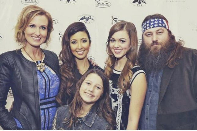 Rebecca Robertson, second from left, with her adopted family, (L to R) Korie, Bella, Sadie and Willie Robertson. (Duck and Dressing)