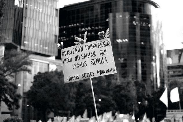 Protest sign in support of the Ayotzinapa students. (CC/jazbeck)