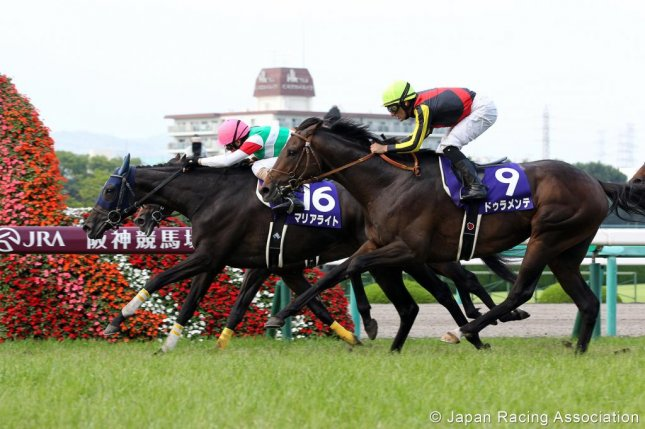Marialite (16) holds off Duramente (9) to win the Grade I Takarazuka Kinen Sunday at Hanshin. Duramente was injured and likely will mss the Arc d'Triomphe in the fall. (JRA Photo)