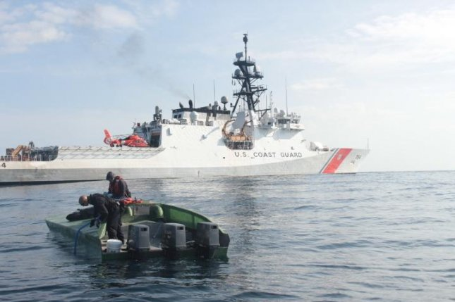 A low-profile go-fast vessel is shown next to the Coast Guard Cutter James in mid-May in the Pacific Ocean off the coast of Central America. Photo courtesy U.S. Coast Guard
