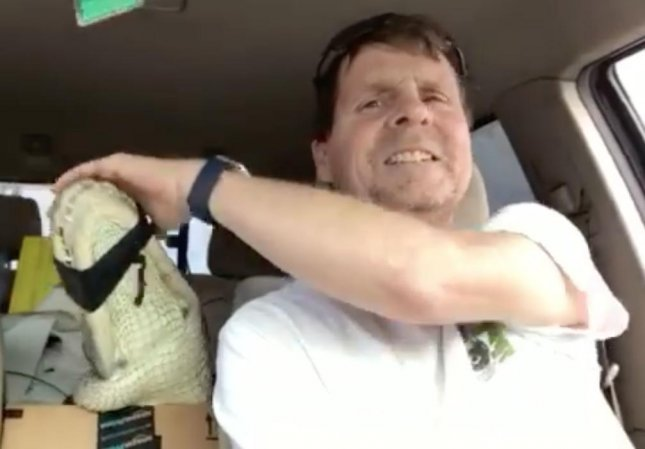 A wildlife removal expert in South Carolina transported an alligator displaced by Hurricane Matthew in the back seat of his truck. The gator was seen emerging from a local beach after the storm and was eventually relocated.  Screen capture/The Snake Chaser/Facebook
