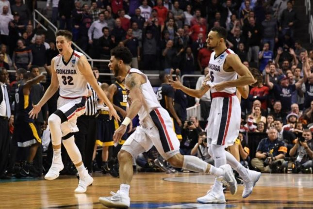 Gonzaga celebrates its Sweet 16 win against West Virginia. (Gonzaga Basketball/Twitter)