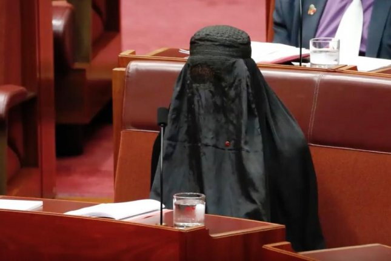 Conservative Australian Sen. Pauline Hanson wears a burqa, a traditional Muslim garment, on the floor of the Senate. Colleagues slammed it as a stunt that mocked members of the Islamic faith. Screenshot: Australian Broadcasting Corp./UPI