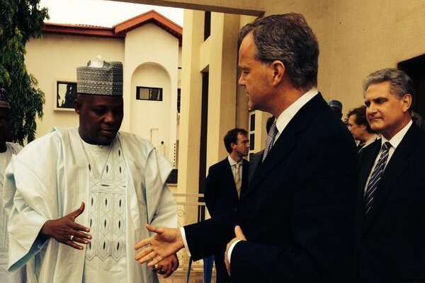 Mark Simmonds, Britain's Minister for Africa, Overseas Territories, the Caribbean, Climate Change and International Energy, extends his hand to Nigeria's Borno state Governor Shettima on May 14, 2014. (Twitter/Mark Simmonds)