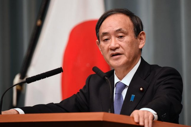 Japanese Chief Cabinet Secretary Yoshihide Suga said a Japanese boat encountered an armed boat in the country's exclusive economic zone in the Sea of Japan. File Photo by Franck Robichon/EPA