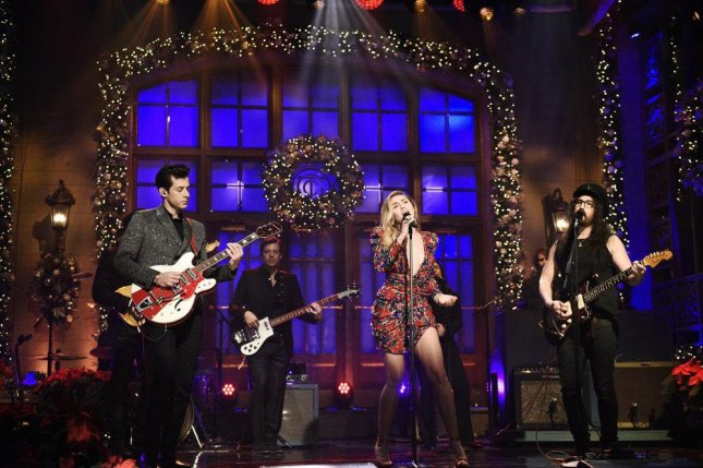 L-R Mark Ronson, Miley Cyrus and Sean Lennon perform on Saturday Night Live. Photo by Will Heath/NBC