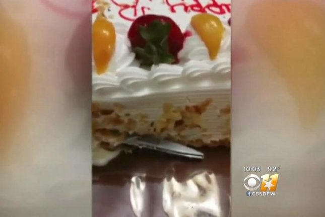 Yoly Nava found scissors in the cake purchased for her mother's surprise party from El Rancho Market in Arlington, Texas. CBS Dallas-Fort Worth video screenshot