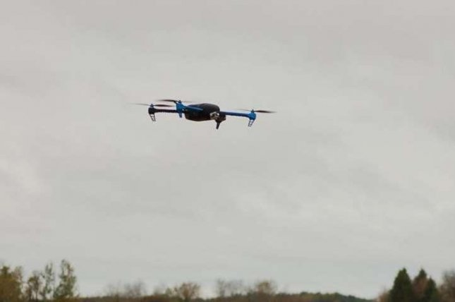 A drone returns from a flight tracking black bears in Minnesota. Photo by Jessie Tanner/University of Minnesota
