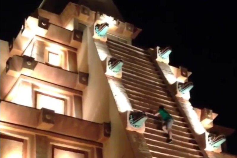 A man climbs the fake pyramid at Walt Disney World's Epcot theme park. @missinth/Instagram video screenshot