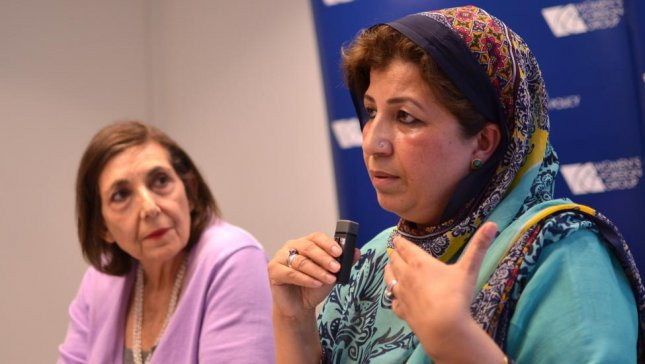 Mossarat Qadeem, founder of nonprofit Paiman Alumni Trust, speaks at Women's Foreign Policy Group event July 1, 2013, on countering extremism in Pakistan, as Patricia Ellis, president of WFPG, looks on. (Kavya Sukumar/MNS/UPI)