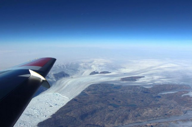 A view out the window of the Operation IceBridge aircraft features Greenland's Helheim Glacier, one of the island's largest and fastest-melting glaciers. Photo courtesy of NASA