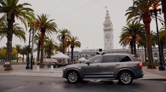 California officials cancelled the registrations for 16 driverless cars Uber is testing there after a video showing one of the cars running a red light surfaced during a review of permits for the cars. Uber officials say they do not need the same types of permits Tesla and Google have obtained because their cars are not truly driverless -- they require a person to monitor the vehicle and take over in extreme circumstances. Photo by Uber