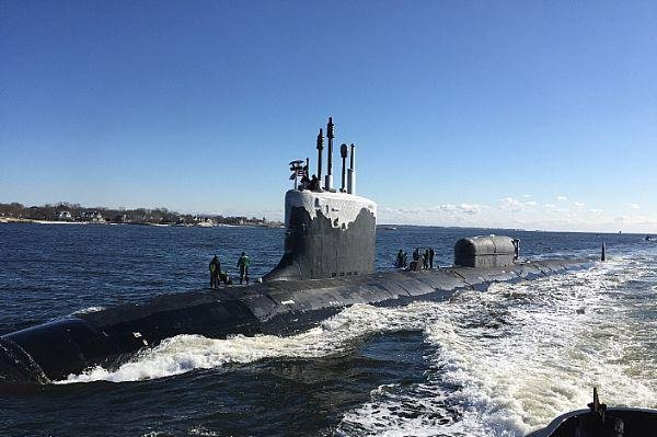 The Virginia-class attack submarine USS North Dakota transits the Thames River en route to reaching its homeport at Naval Submarine Base New London in Groton, Conn. Photo by Cmdr. Jason M. Geddes/U.S. Navy