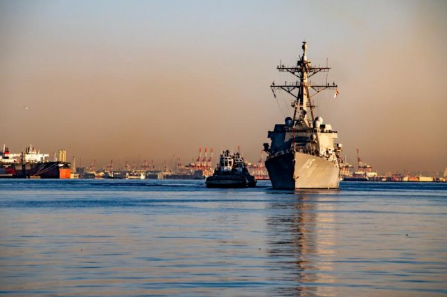 The Arleigh Burke-class guided missile destroyer USS Rafael Peralta arrives at Fleet Activities Yokosuka after completing a homeport change from San Diego, Calif., to join U.S. 7th Fleet. Photo by Taylor Curry/U.S. Navy