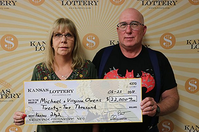A Kansas couple said a lottery ticket that got caught in a paper jam while printing turned out to be a $22,000 winner. Photo courtesy of the Kansas Lottery