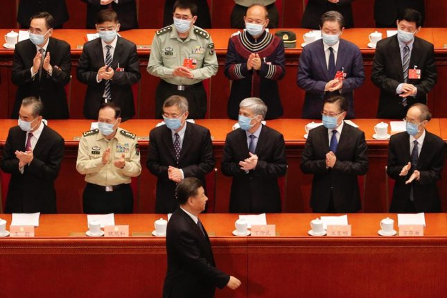 Delegates wearing face masks applaud as Chinese President Xi Jinping (C, bottom) arrives for the opening of the third plenary session of the 13th National Committee of the Chinese People's Political Consultative Conference in Beijing on Thursday. File Photo by Andy Wong/EPA-EFE