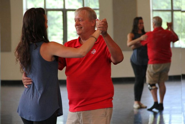 Tim Hickey, who had peripheral neuropathy after chemotherapy, dances the Argentine tango with Mimi Lamantia to build strength and balance after surviving cancer. Photo by Ohio State University
