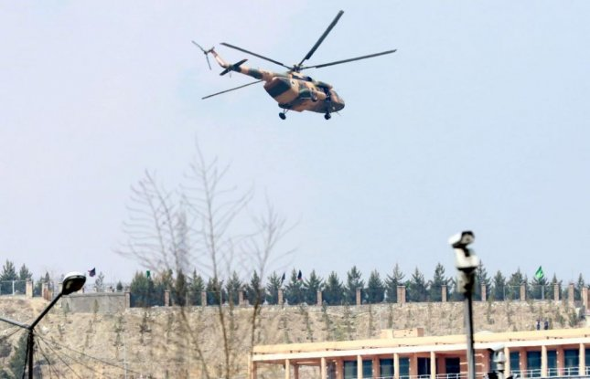 An Afghan army helicopter lands atop Kabul's Sardar Monhammad Daud Khan Hospital Wednesday, where at least 30 people died in an attack by a suicide bomber and gunmen. The Islamic State took responsibility for the attack. Photo by Hedayatullhah Amid/EPA
