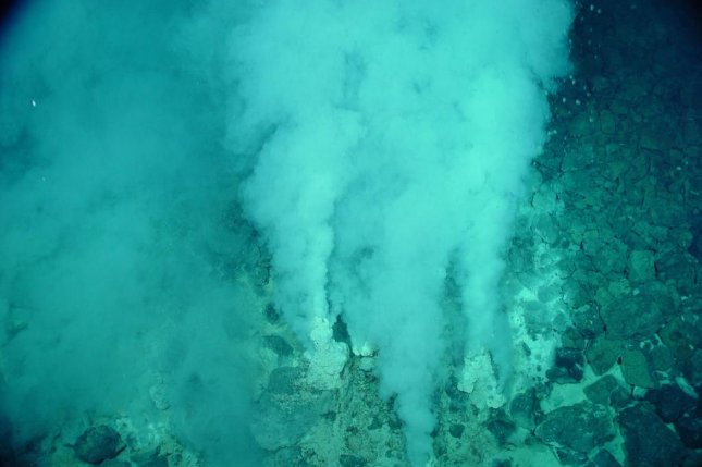Lab experiments suggest deep sea vents provide the right combination of warmth, alkalinity and salt to encourage the formation of protocells, the first step in the development of life. Photo courtesy of NOAA