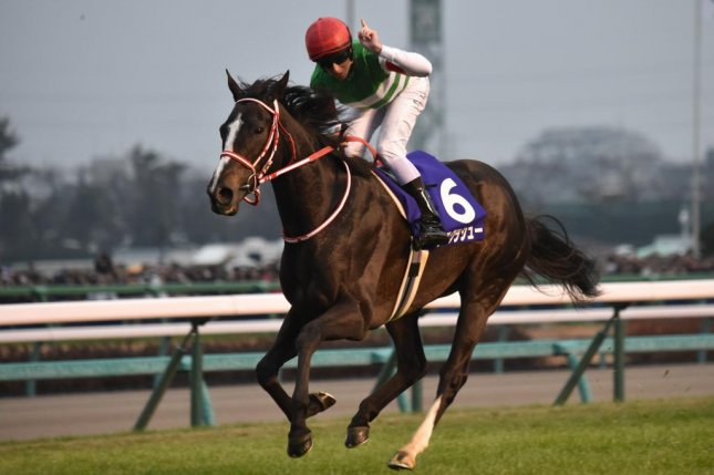 Lys Gracieux cruises to victory in Sunday's Grade 1 Arima Kinen in Japan. Photo courtesy of Kasumi Saito