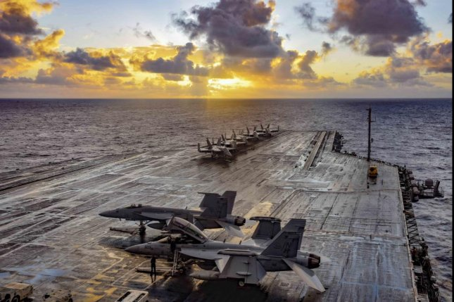 The aircraft carrier USS Theodore Roosevelt transits the Philippine Sea Monday. Photo by Julian Davis/U.S. Navy