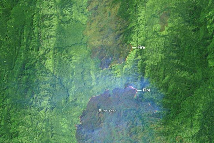 Landsat 8 images show the fires in Huai Kha Khaeng Wildlife Sanctuary in false color. Photo by NASA/ESO