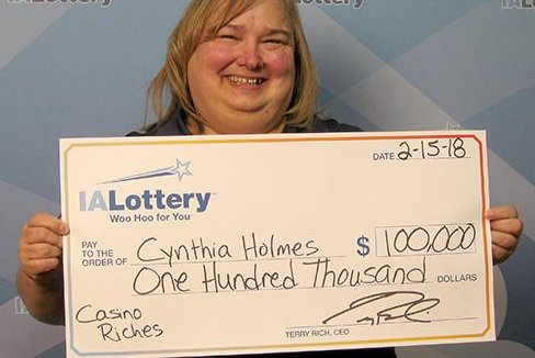 An Iowa woman said her husband only spent $10 on her Valentine's Day gift -- but the scratch-off lottery ticket won her $100,000. Photo courtesy of the Iowa Lottery