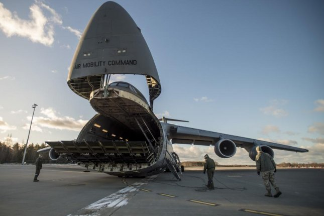 U.S. Airmen Get Ready To Receive Supplies From A C 5 Galaxy Cargo Plane  That Were Delivered In Support Of The Theater Security Package 18.1 On Jan.  8, 2018. Great Pictures