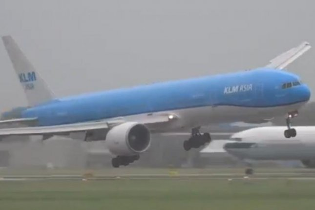 A KLM plane gets pushed around by the wind while attempting to land in Amsterdam. Storyful video screenshot