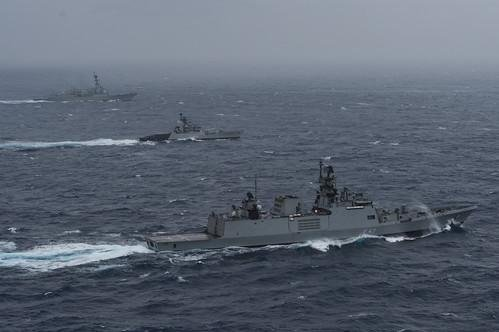 Ships of the Indian navy and U.S. Navy sail in formation in the Bay of Bengal. File Photo by MC3 Cole Schroeder/U.S. Navy